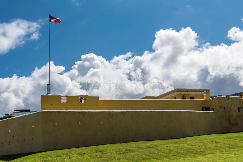 Exterior of Fort christiansted in St. Croix Virgin Islands. Fort walls and US Flag royalty free stock photos