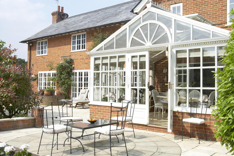 Exterior Of House With Conservatory And Patio royalty free stock images