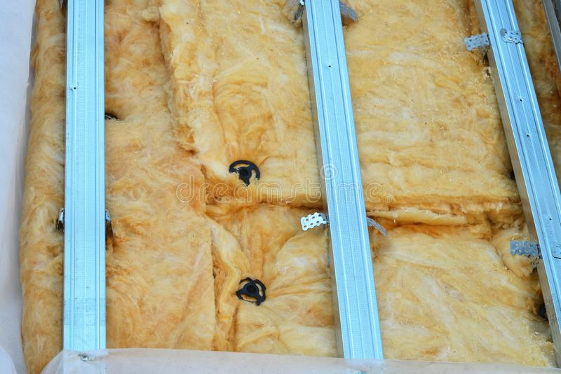 Exterior house wall heat insulation with mineral wool closeup, unfinished result of installing insulate panels. Exterior house wall heat insulation with mineral royalty free stock photo