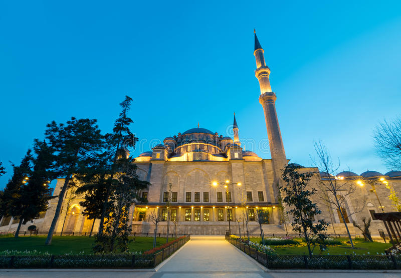 Exterior low angle night shot of Fatih Mosque, an Ottoman imperial mosque located on Istanbul, Turkey royalty free stock photo
