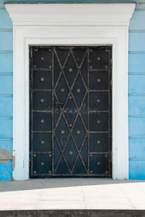 Iron forged door, close up royalty free stock photos