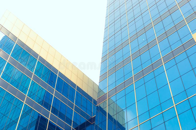 Perspective and underside angle view to textured background of modern glass building skyscrapers stock photo