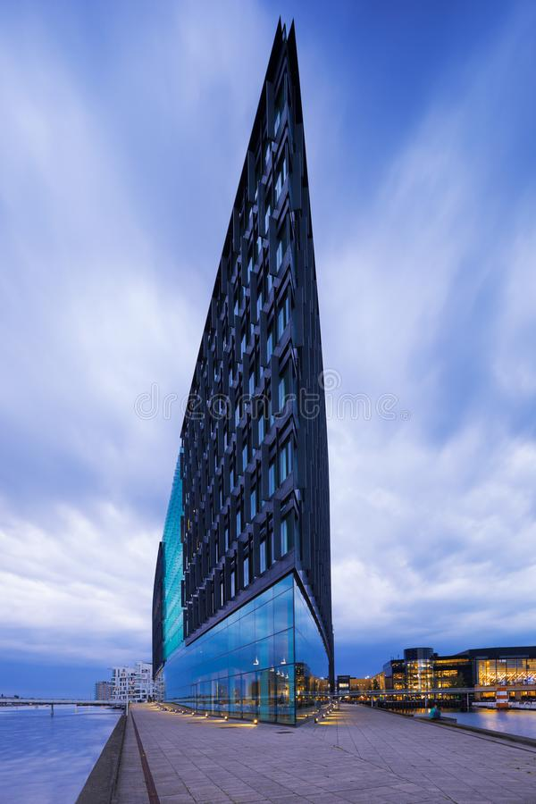 Exterior of modern glass building. Exterior of modern building. Sword in the ocean royalty free stock photography