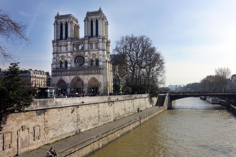 Exterior of Notre Dame Cathedral Viewed from the Seine River stock photo