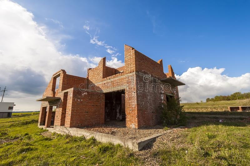 Exterior of an old building under construction. Orange brick walls in a new house. royalty free stock photos