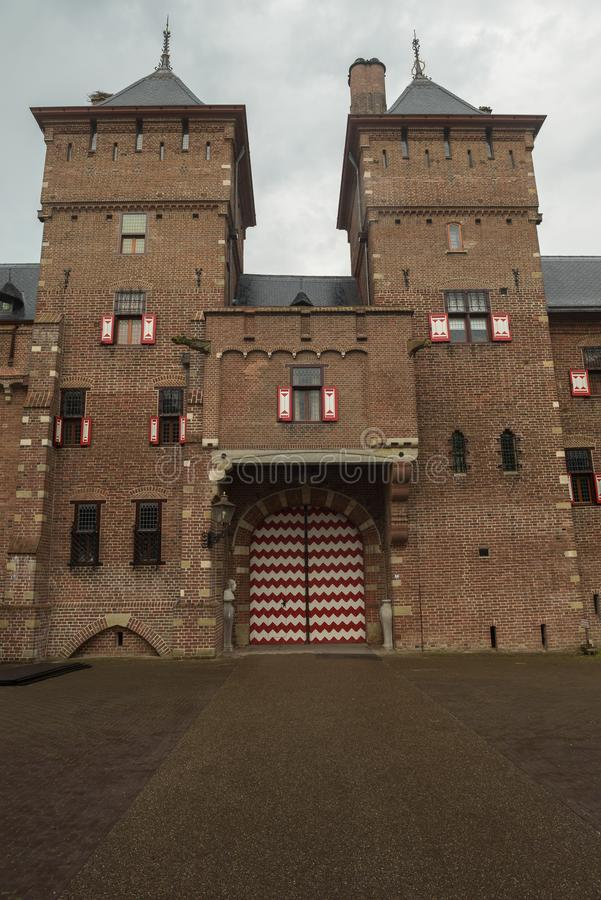 Exterior of parts of De Haar Castle with towers and windows in neo gothic style. As designed by architect Pierre Cuypers stock photos