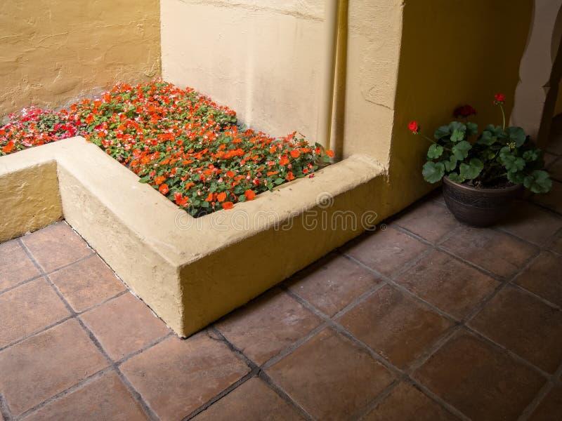 Exterior passageway, Spanish architecture. Flowers, tile and stucco, passageway to Spanish style hotel stock photo