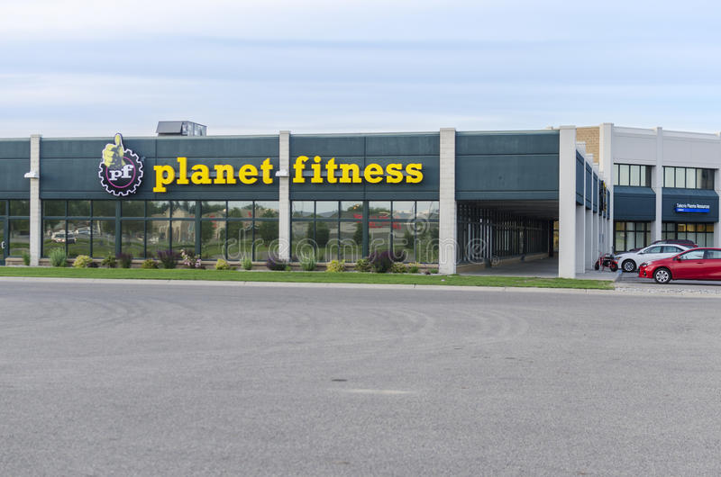 Exterior Of Planet Fitness At Industrial Area. Moorhead, Minnesota, United States - June 19th, 2015: Exterior of Planet Fitness with carpark in industrial area stock photography