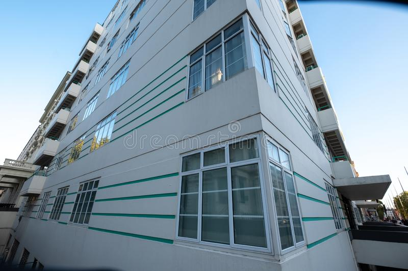 Exterior of 59 - 63 Princes Gate, beautiful white painted art deco block of flats with green horizontal stripes, London UK stock photos