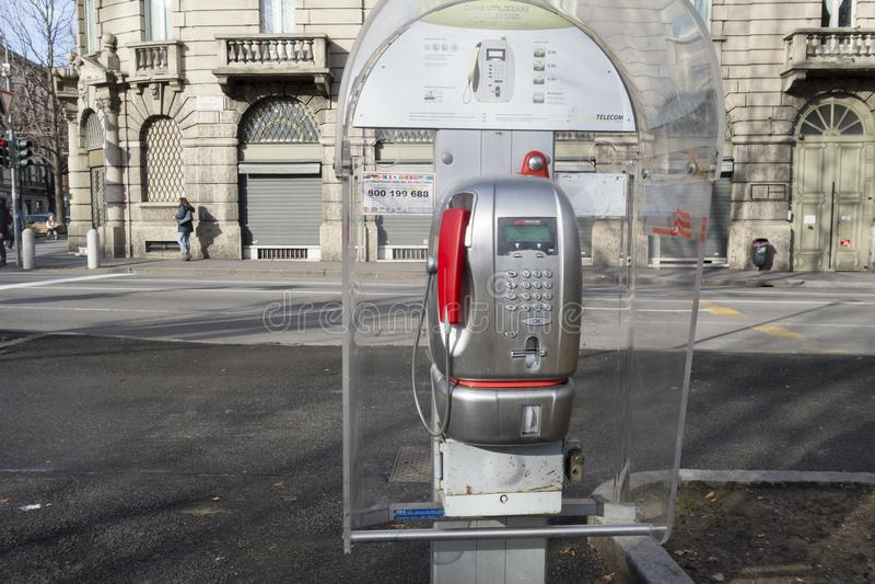 Exterior public phone point street in Bergamo,Lombardy,Italy. stock image
