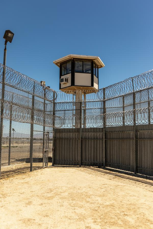 Exterior shot of Prison Yard and guard tower with no people royalty free stock photography