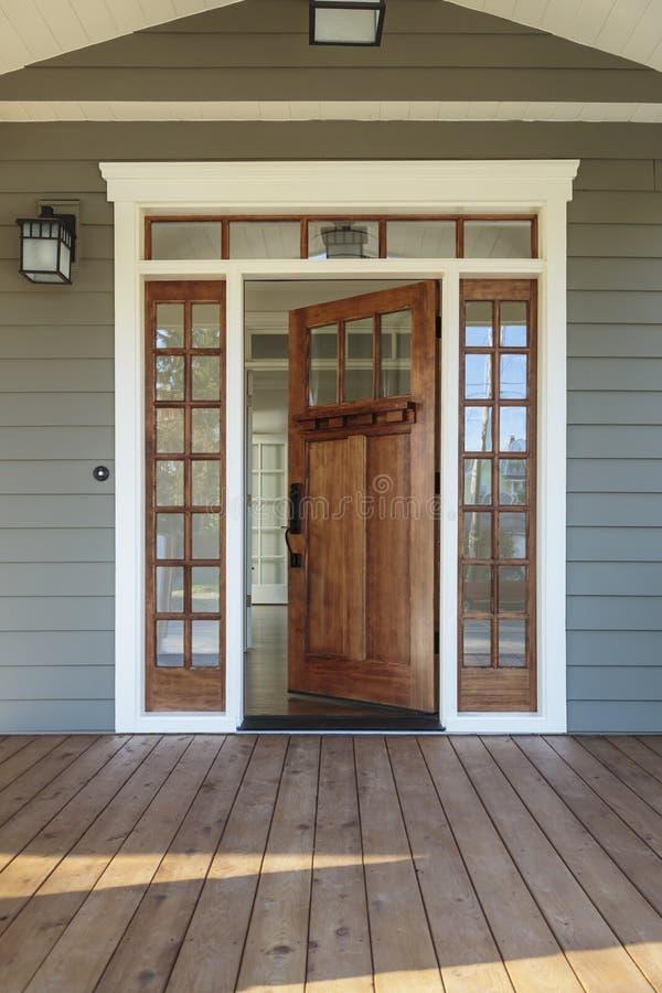 Free Exterior Shot Of An Open Wooden Front Door Stock Photography - 36650132