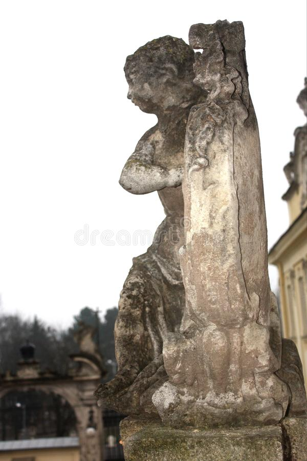 Exterior of St. Georges Cathedral in Lviv, Ukraine. Angels, cherubs statues on the banister of stone staircase. Elements of exterior decoration in the yard of St royalty free stock photo