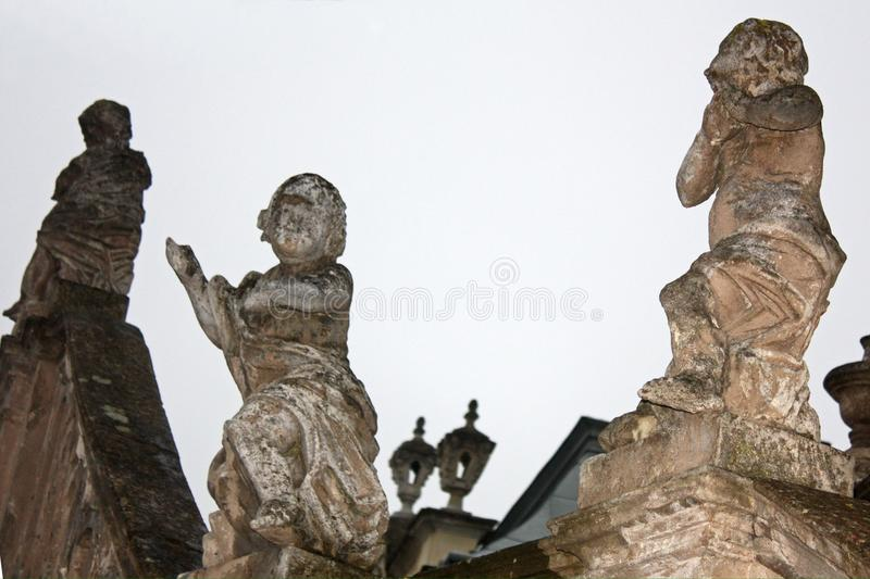 Exterior of St. Georges Cathedral in Lviv, Ukraine. Angels, cherubs statues on the banister of stone staircase. Elements of exterior decoration in the yard of St royalty free stock images