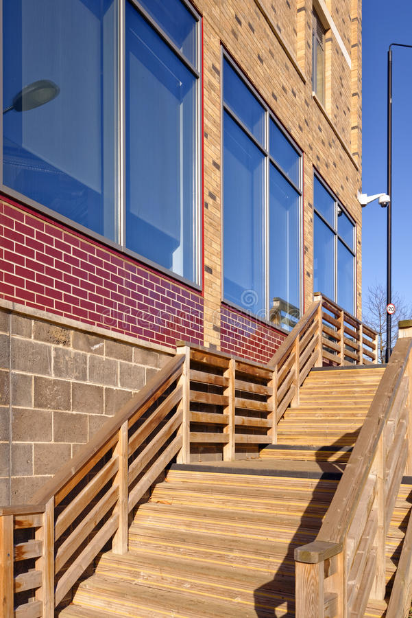 Exterior stairs. Image taken of modern exterior wooden stairs outside a modern building in kings cross central, london, uk stock images