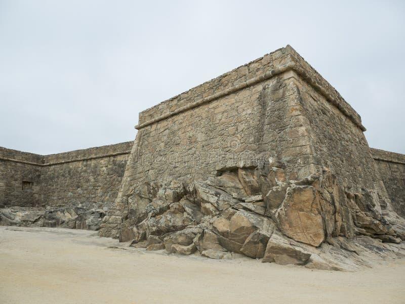 Exterior stone walls of historic 17th century coastal fort in Vila do Conde, Portugal. Fort of John the Baptist / Joao Batista. Built into rocks stock image