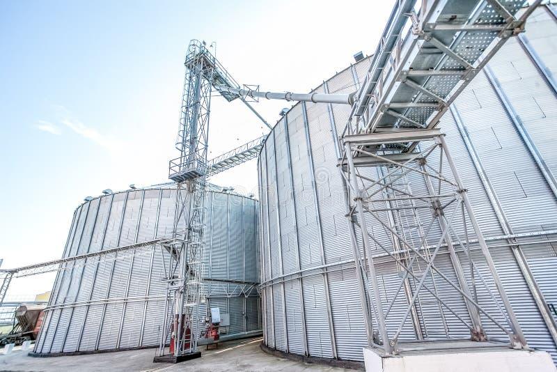 Exterior of storage grain silos at factory stock photos