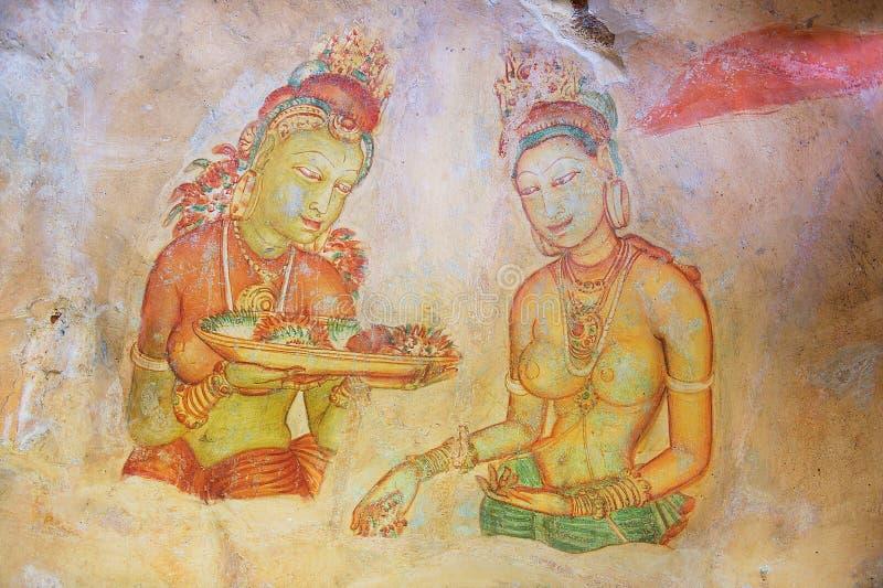 Exterior of the 5th century fresco wall paintings of Sigiriya rock fortress in Sigiriya, Sri Lanka. stock images