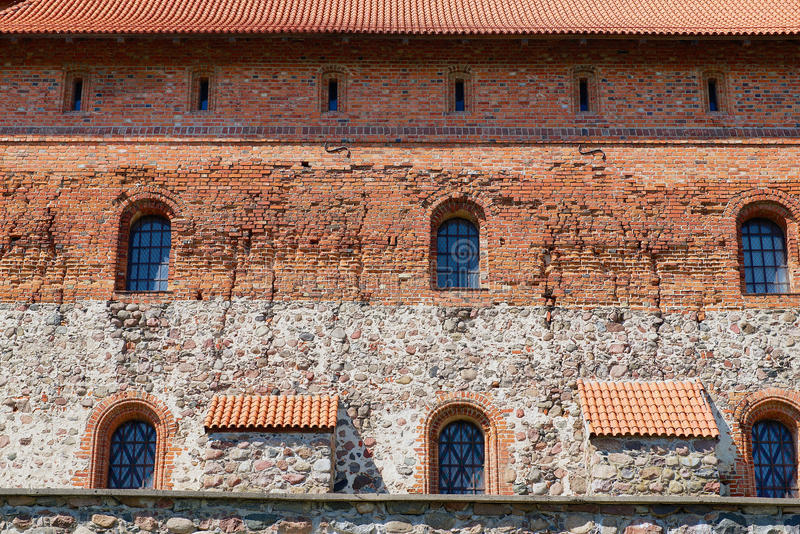 Exterior of the Trakai castle old brick wall with a windows in Trakai, Lithuania. royalty free stock photography