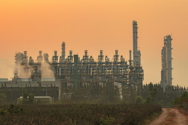Exterior tube of petrochemical plant and oil refinery for produce industrial material in heavy petroleum industry estate against. Beautiful sun light sky stock image
