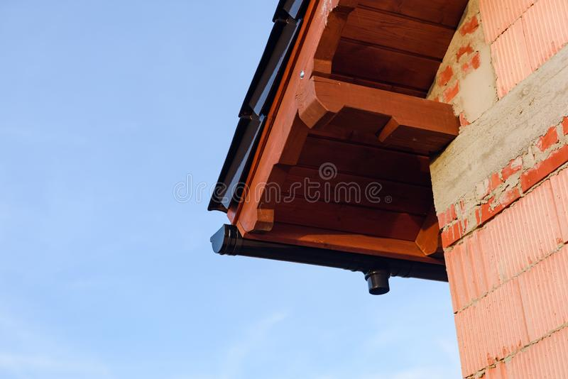 Exterior of a Unfinished Red Brick House Walls under Construction with Roof. opy space. Blue Sky stock images
