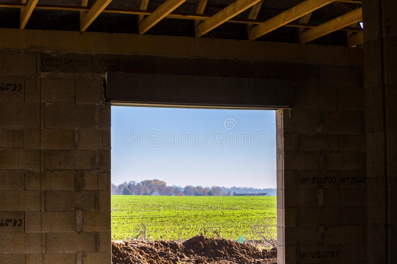 Exterior view from a building under construction. Viewing the outside field on a sunny day from a building still under construction stock photography