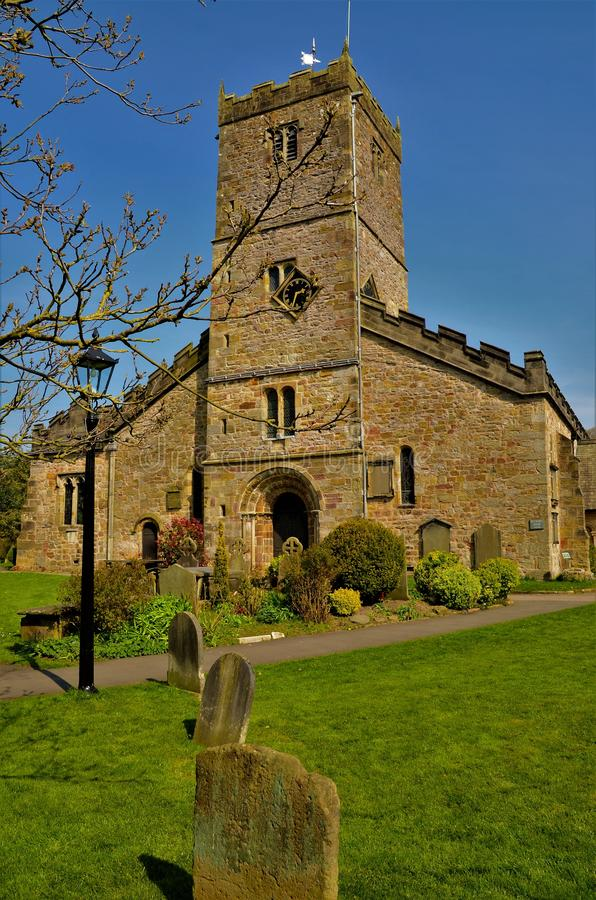 Landmarks of Cumbria - Kirkby Lonsdale Church. An exterior view of the church building and graveyard in Kirkby Lonsdale in Cumbria royalty free stock images