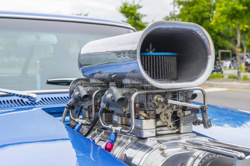 Classic car hood with super charger. Exterior view of drag racing car with super charger and air intake royalty free stock photo