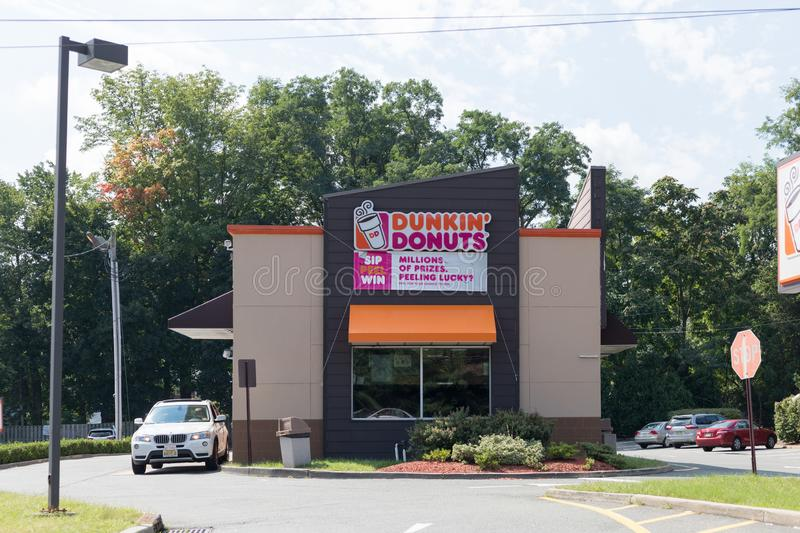 An exterior view of a Dunkin Donuts coffee shop in New Jersey. royalty free stock photos