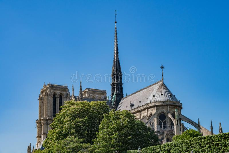 Exterior view of the famous Notre-Dame Cathedral via the rivier. At Pairs, France royalty free stock image