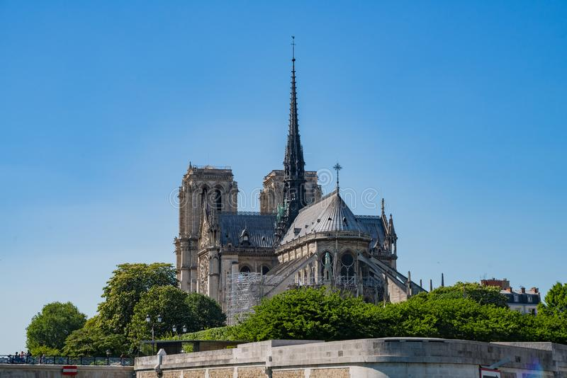 Exterior view of the famous Notre-Dame Cathedral via the rivier. At Pairs, France stock image