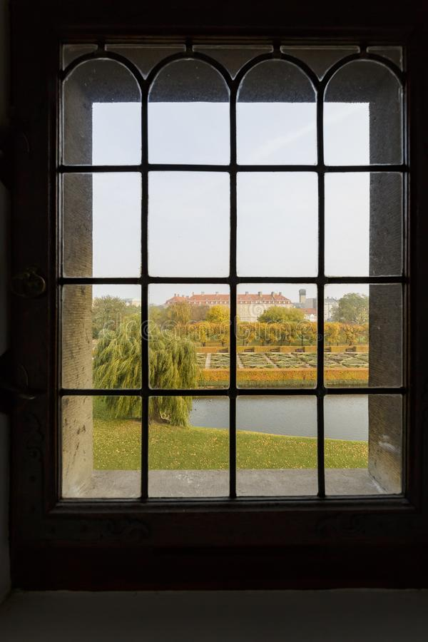 Exterior view of the famous Rosenborg Slot form a window. Exterior view of the famous Rosenborg Slot from a window at Copenhagen, Denmark royalty free stock image