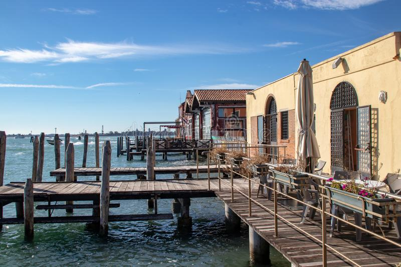 Exterior View of a Glass Making Facility on the Island of Murano. An exterior view of the docks of a glass making factory on Murano, an island a short distance royalty free stock photography