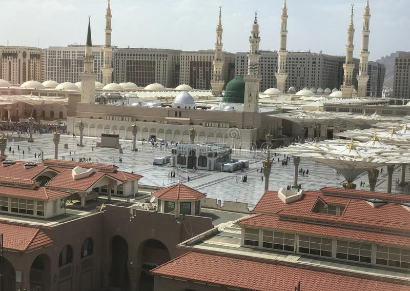 Exterior view of minarets and green dome of a mosque taken off the compound. masjid Al Nabawi minaret and green dome in Madinah,. Saudi Arabia stock photography