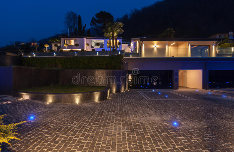 Exterior view of a modern luxury villa, nocturnal scene stock image