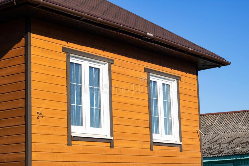 Exterior view of wooden house and windows royalty free stock photo
