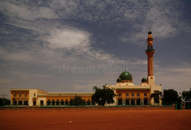 Exterior view to Niamey Grand mosque in Niamey, Niger. Exterior view to Niamey Grand mosque, Funded with money from Libyan Government of Gaddafi, Niamey, Niger royalty free stock photography