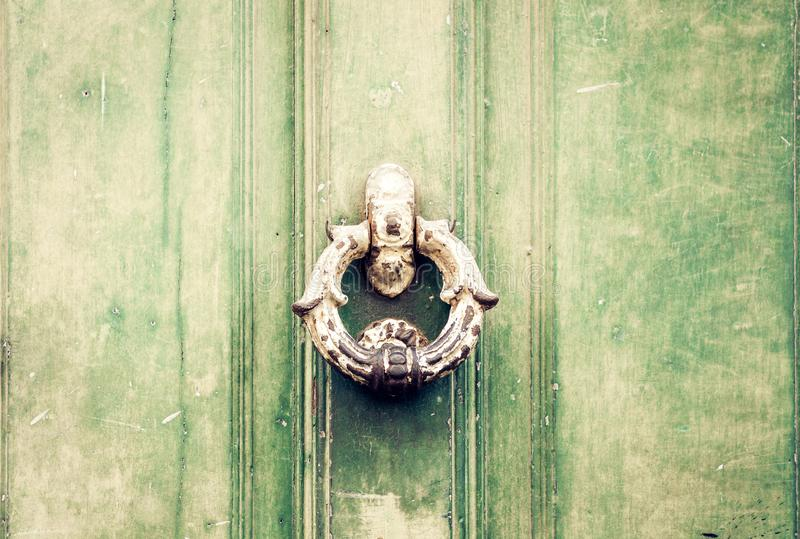 Exterior vintage door knocker metal circle on a door of an ancient building in Catania, Sicily, Italy.  stock photography
