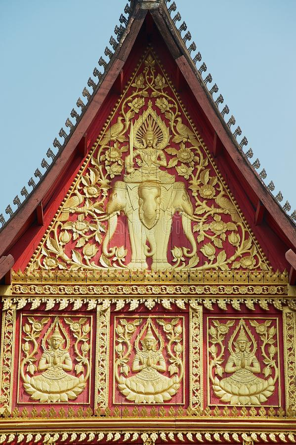 Exterior wall gold painted decoration of the Haw Phra Kaew building in Vientiane, Laos. VIENTIANE, LAOS - APRIL 23, 2012: Exterior wall gold painted decoration stock photos