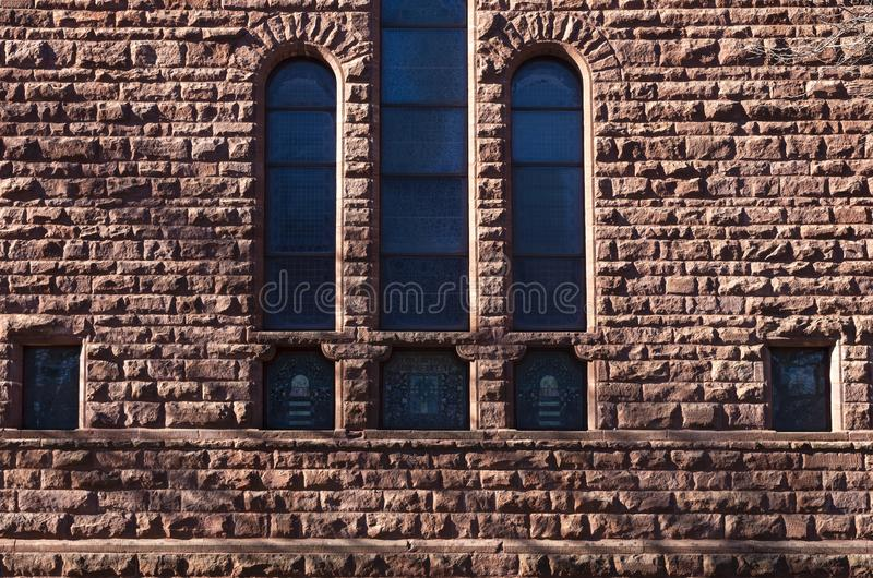 Exterior Wall and Windows of Church. Stained glass windows and exterior wall of church building royalty free stock photography