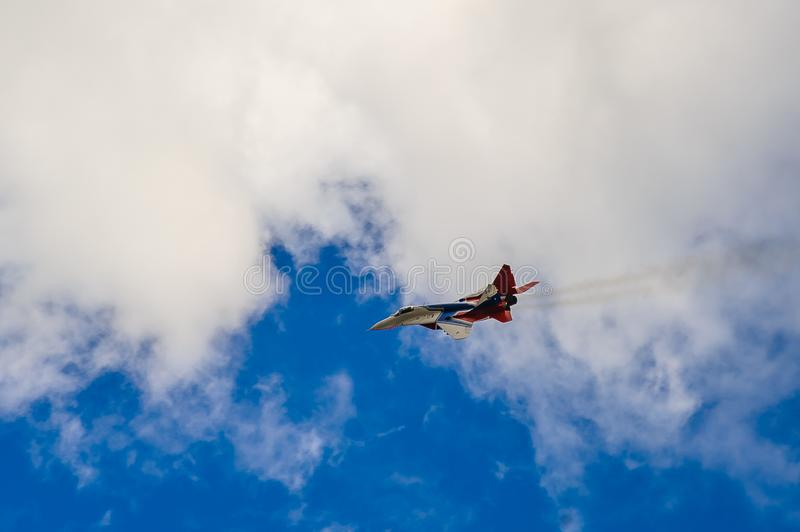 Exterminator in the sky over the city stock photography