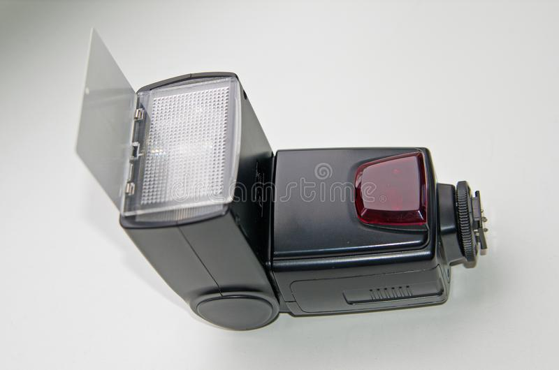External flash for a SLR camera, on a gray background royalty free stock photo