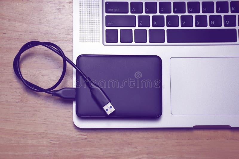 External hard disk and laptop computer stock photo