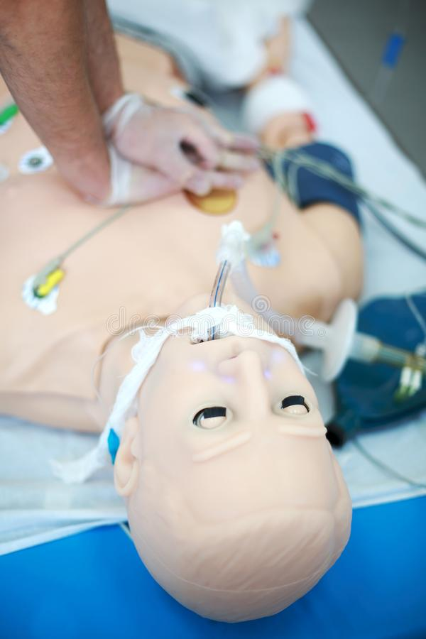 CPR. External heart massage in CPR training. Medical skills training. Modern technologies in training stock photos