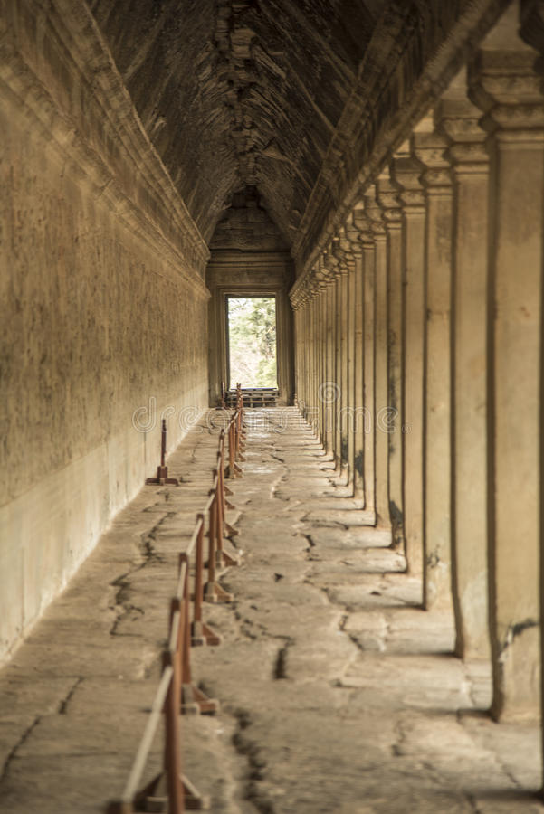 External passageway in Angkor Wat. Angkor Wat (Khmer: អង្គរវត្ត or Capital Temple) is a temple complex in stock photography