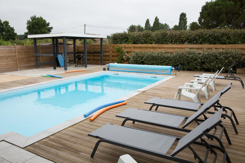 External view of a contemporary house with pool stock photos
