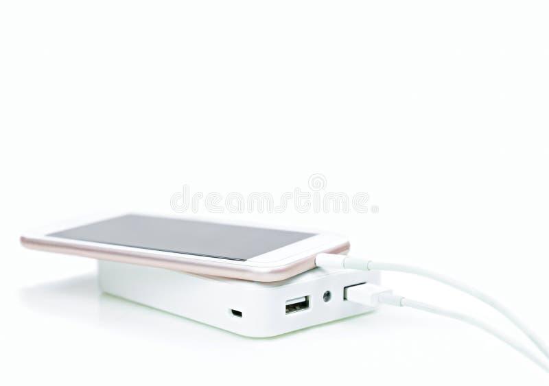 Externo de la batería o banco del poder para el smartphone con el cable fotografía de archivo