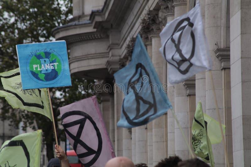 Extinction Rebellion flags on The Strand, London. stock image