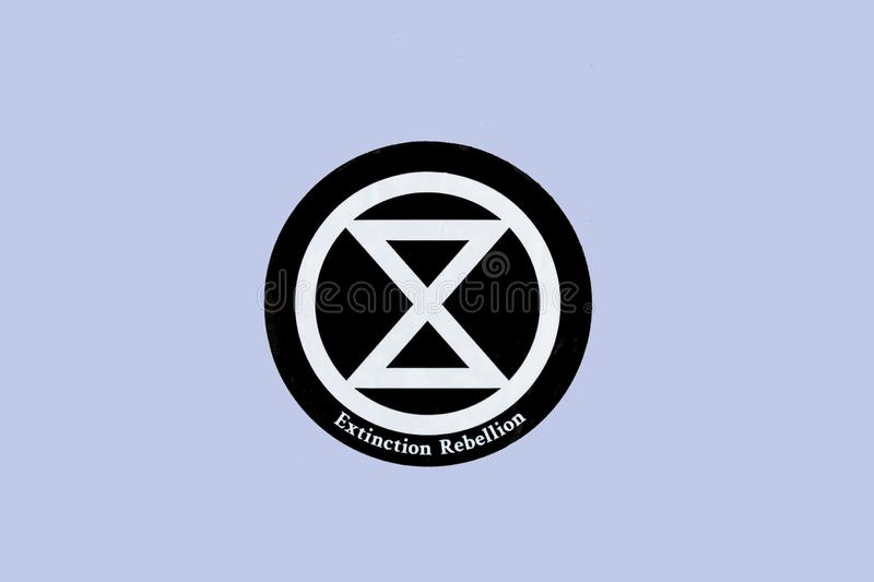 Extinction Rebellion sign on the wall at the street. London, UK - June 2019 royalty free stock images