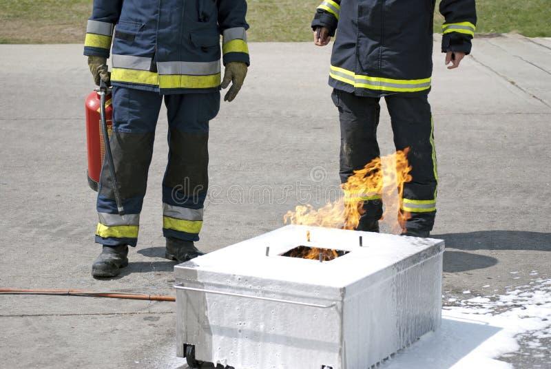 Extinguidor de la explotación agrícola del bombero imagen de archivo